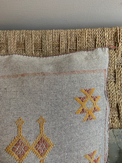light gray pillow with yellow details