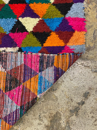 colorful rug with triangle pattern