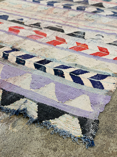 white, blue and violet moroccan vintage rug