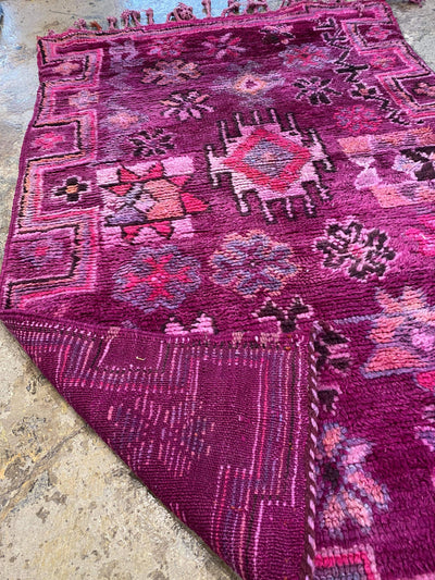 purple vintage nursery carpet with colorful designs