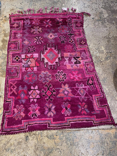 soft handmade antique carpet with tribal design