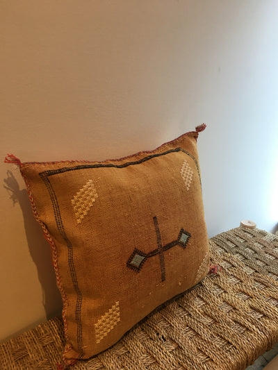 square decorative orange pillow