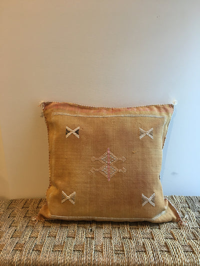 orange moroccan pillow embedded with beige design