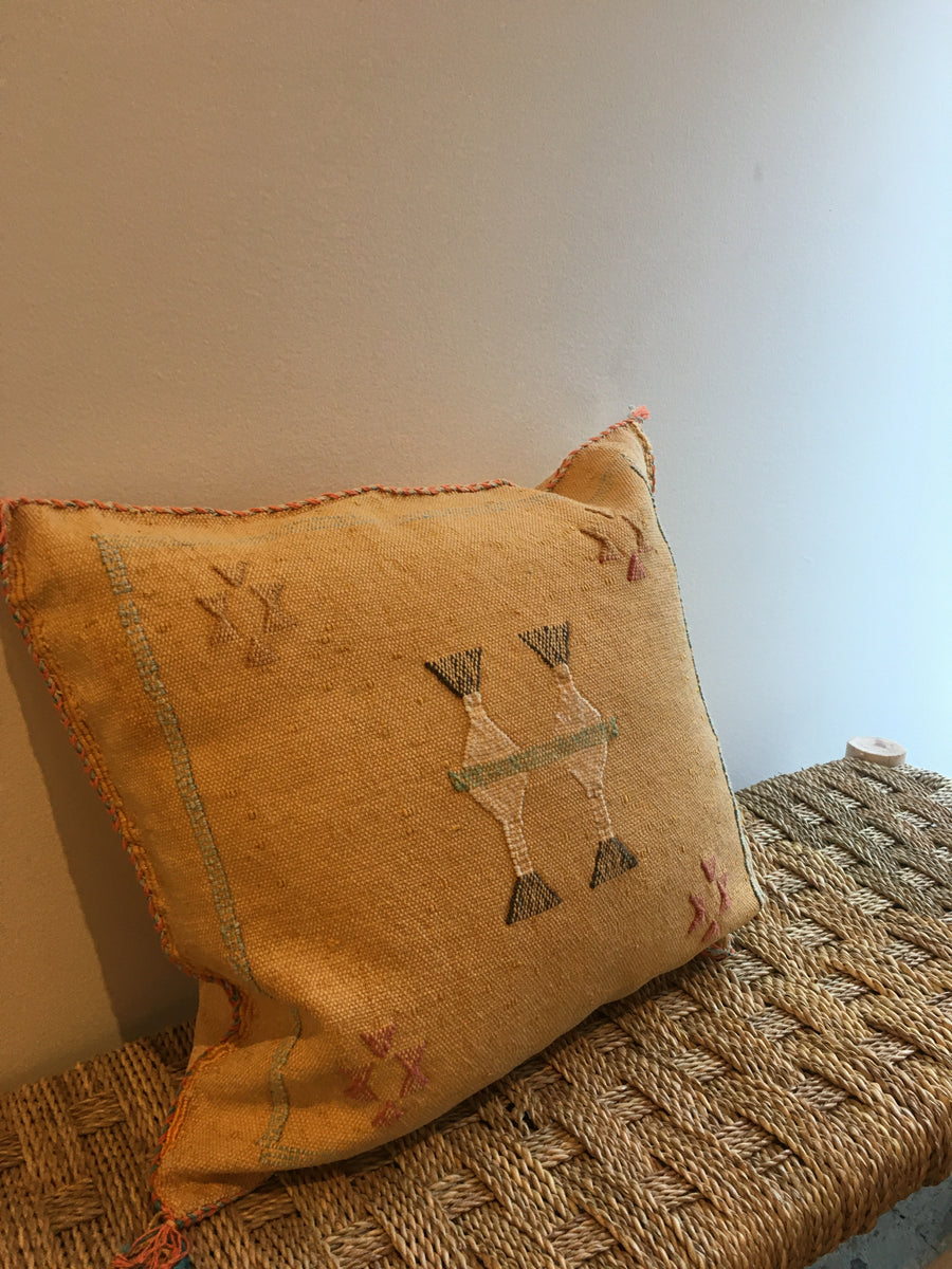 square yellow decorative pillow