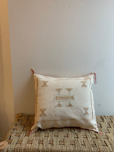 beige square moroccan pillow