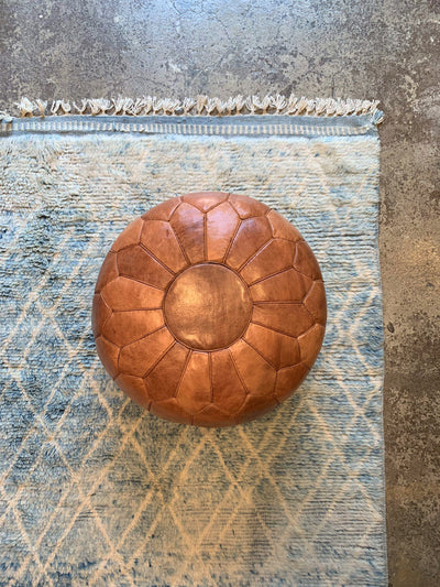High round tan leather pouf