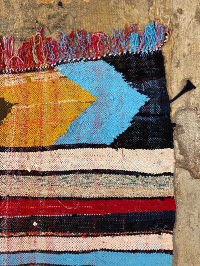 moroccan rug with colorful tassels