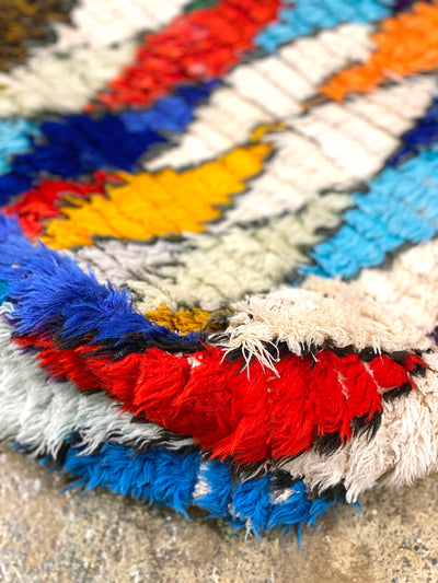 close up on colorful wool on moroccan pouf
