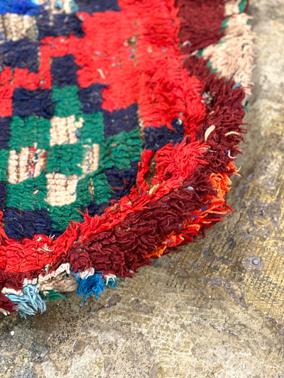 red wool pouf with tribal blue design