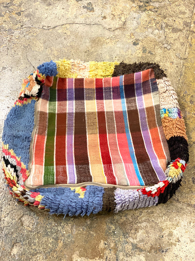 back of bohemian antique pouf with geometrical design