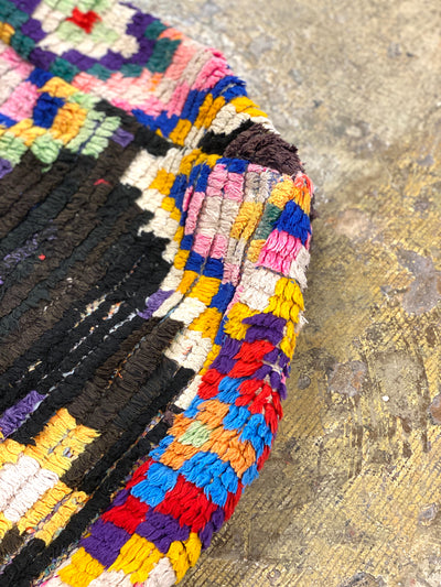 colorful wool details on bohemian ottoman