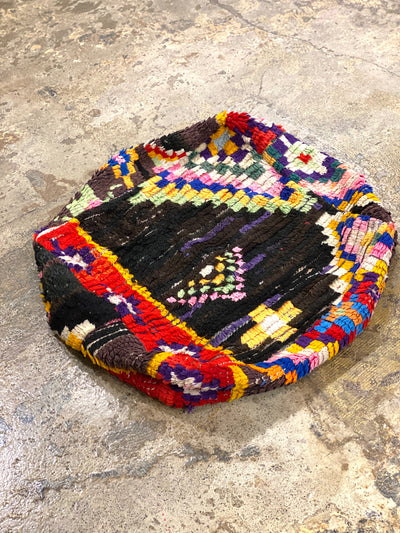 brown eclectic pouf with colorful tribal design