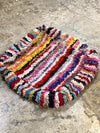 nursery floor pillow with colorful stripes