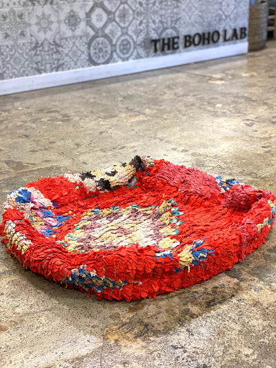 red vintage floor pillow with colorful moroccan design