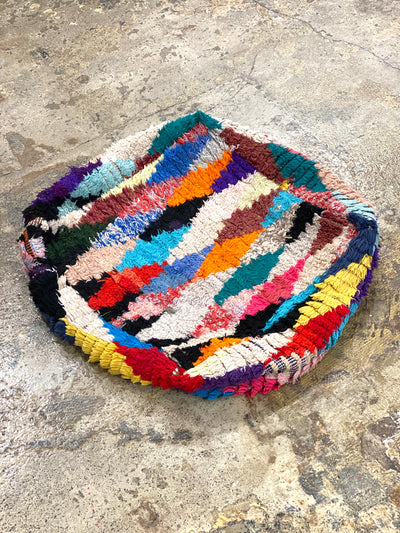 colorful vintage floor cushion with geometrical designs