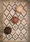 cream flateweave moroccan rug with many moroccan floor cushions