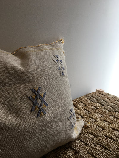 natural moroccan cushion with blue and yellow tribal designs
