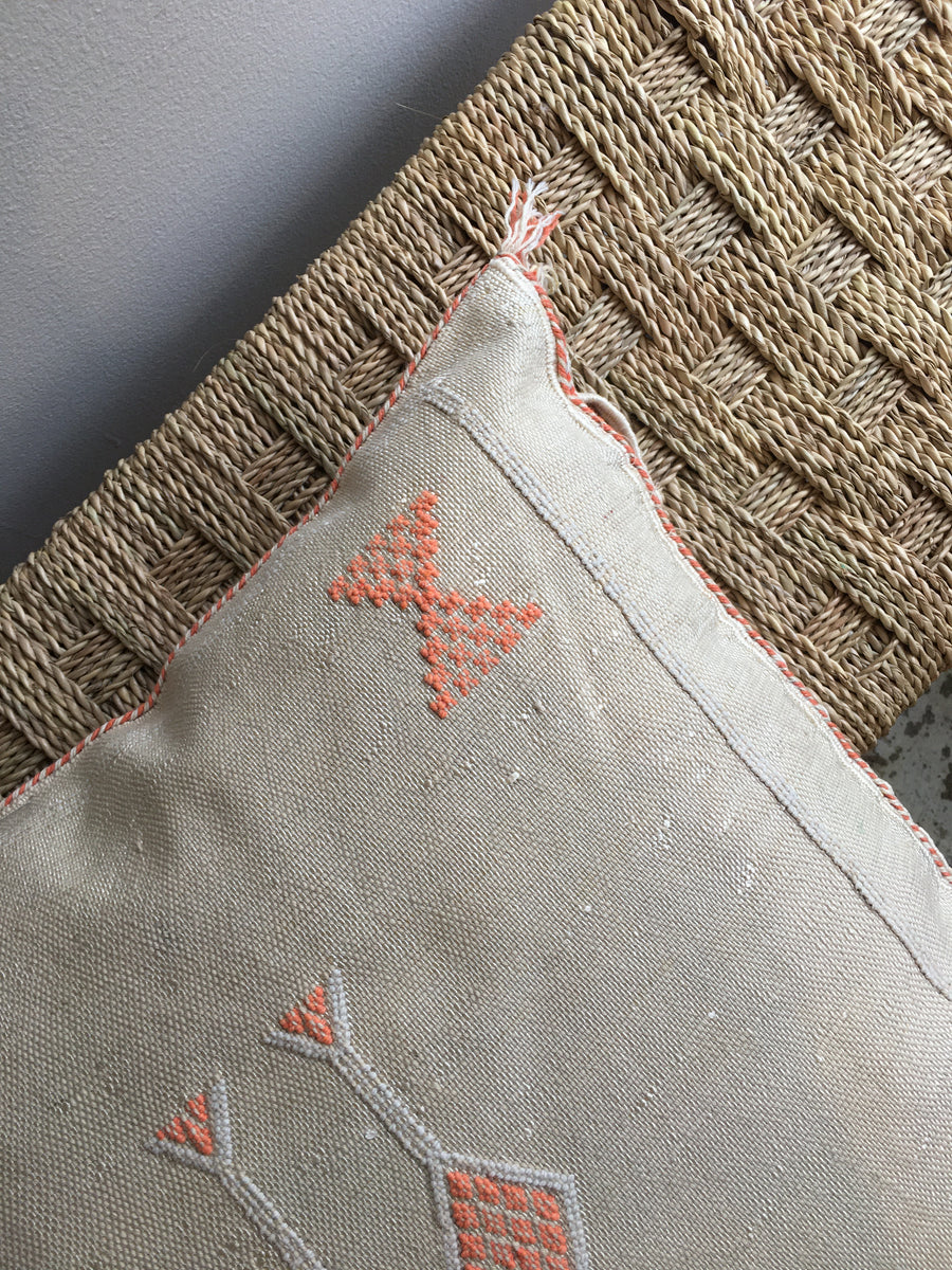 square beige moroccan sabra pillow with orange diamond shapes