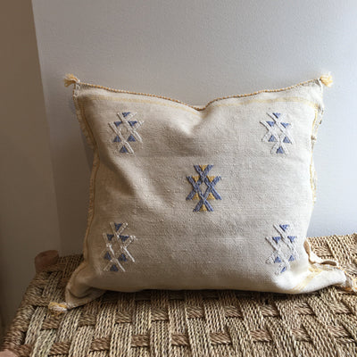 square beige moroccan cactus silk pillow with blue and yellow design