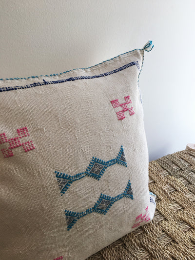 white square moroccan pillow with blue and red details