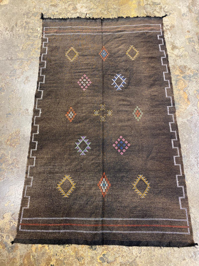 brown cactus silk rug with tribal designs