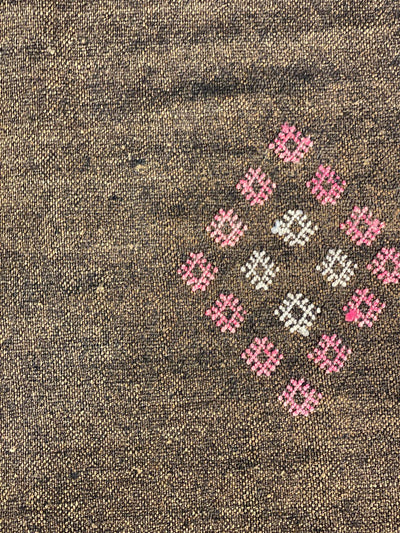 close up on handwoven pink and white diamond shapes