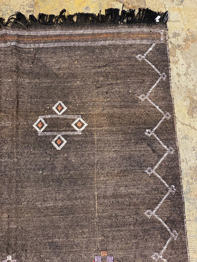 corner of dark cactus silk moroccan carpet
