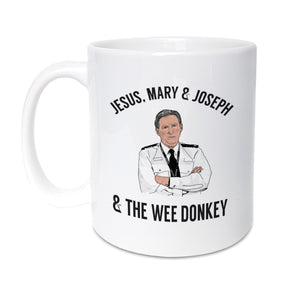 High Quality 11oz mug designed & made in the UK.  Inspired by popular TV show Line of Duty. A unique mug featuring hand drawn illustration of Ted Hastings featuring his famous quote 'Jesus, Mary & Joseph & the wee donkey'.   Mug reads: Jesus, Mary & Joseph & the wee donkey