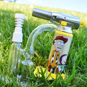 "Glass shoe bubbler rig next to ErrlyBird's ""Rick & Morty"" themed Torch Art - Trippy Torches & Lighters Collection"