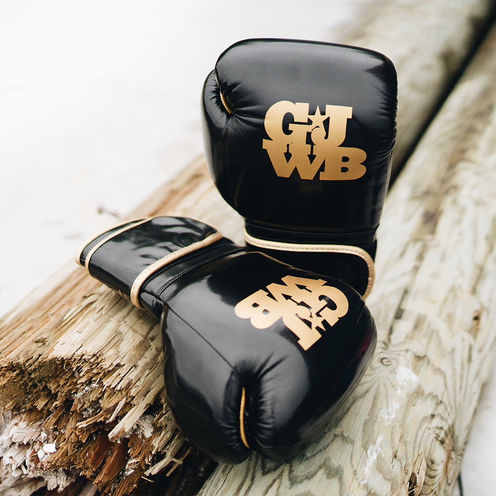 Black women's boxing gloves with gold GJWB logo
