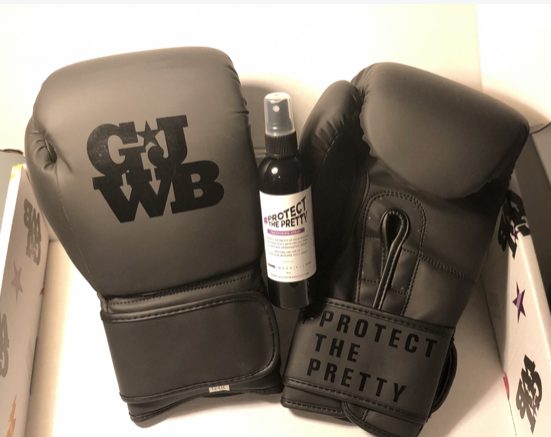 Matte black women's boxing gloves in packaging