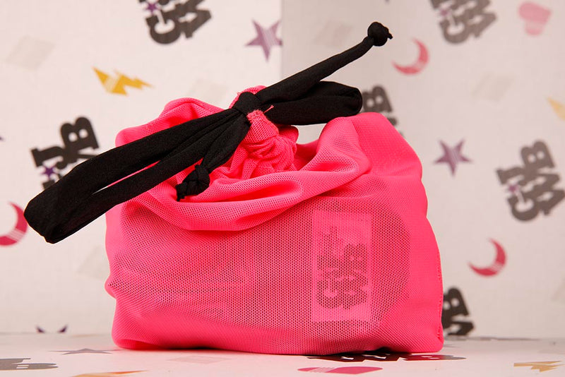 Bright pink fabric boxing glove bag with black drawstring