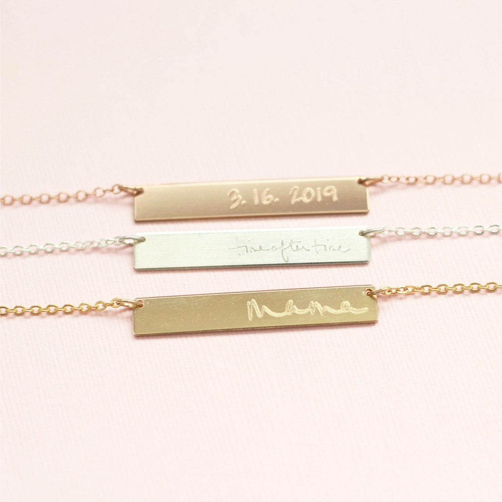 Three handmade custom handwriting bar necklaces in sterling silver, gold and rose gold