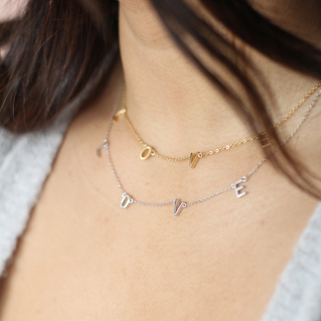 LOVE letter necklace in gold and silver