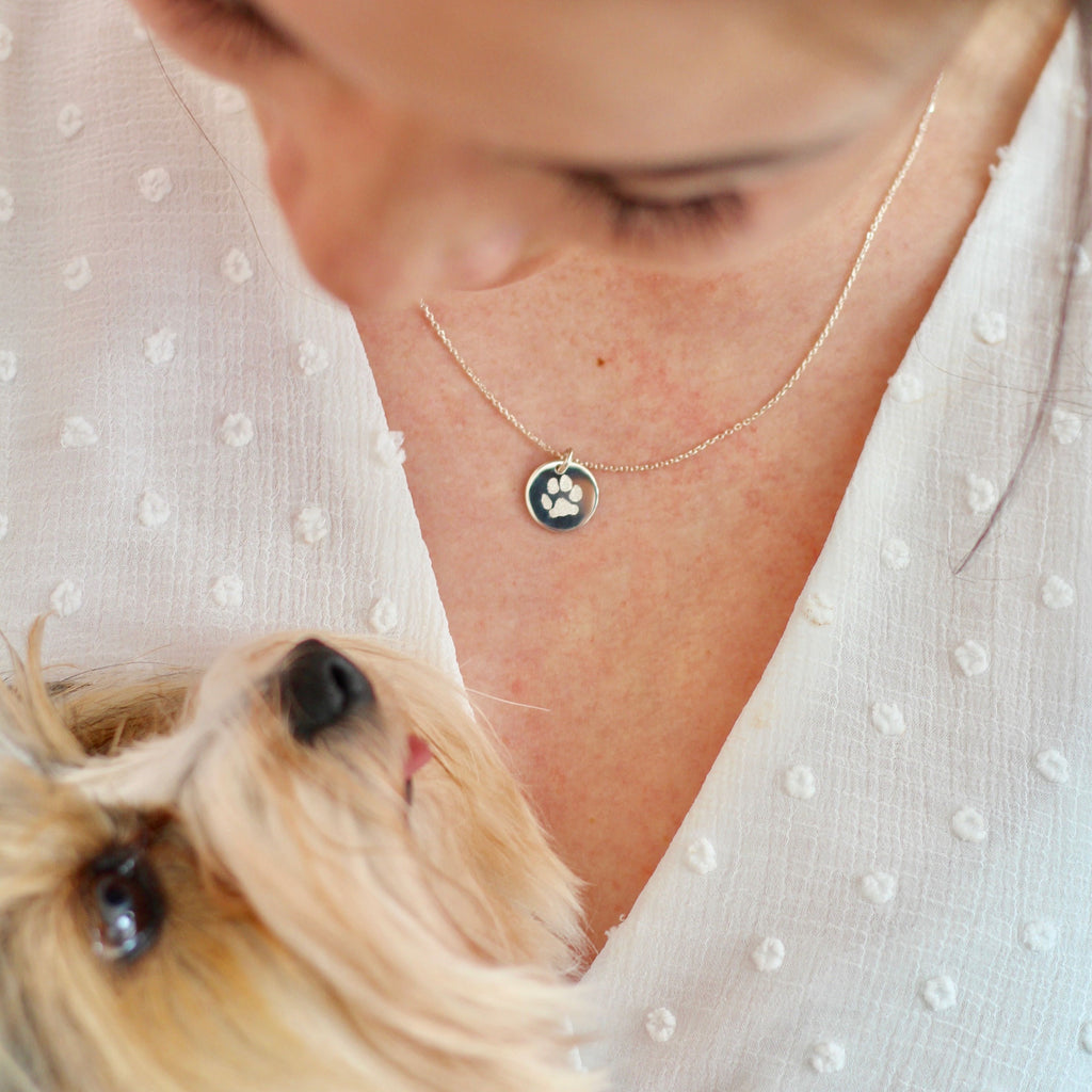 Woman is wearing a pet jewelry made in Canada.