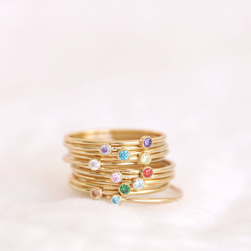 Handmade sterling silver and gold gilled birthstone rings sustainably made in Canada