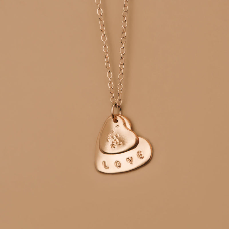 hand stamped zodiac double heart necklace