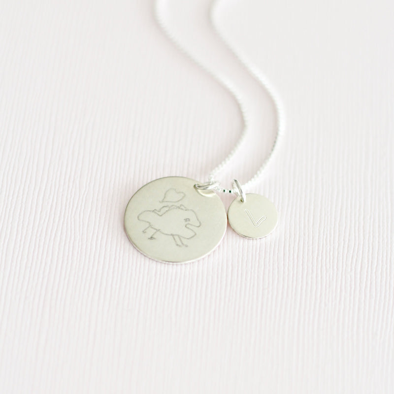 Handmade sterling silver custom drawing coin necklace using child's actual drawing