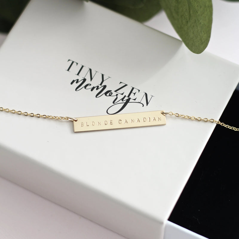 Gold handmade personalized bar necklace with custom message hand stamped on necklace