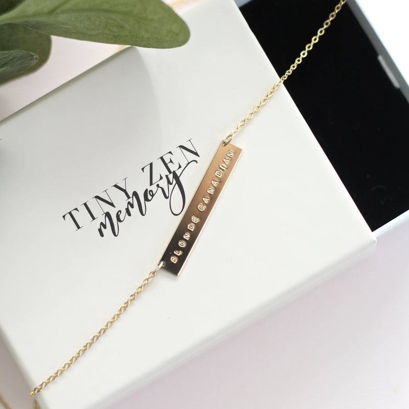 handmade custom gold bar necklace with personal hand stamped message