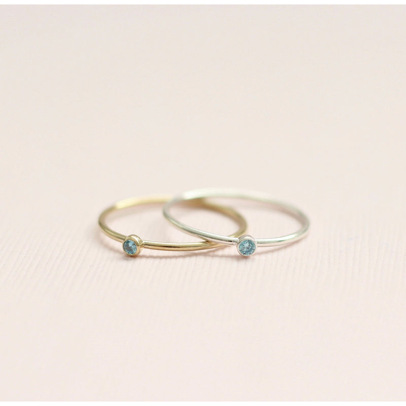 Handmade blue topaz December birthstone ring made with sterling silver and gold-filled