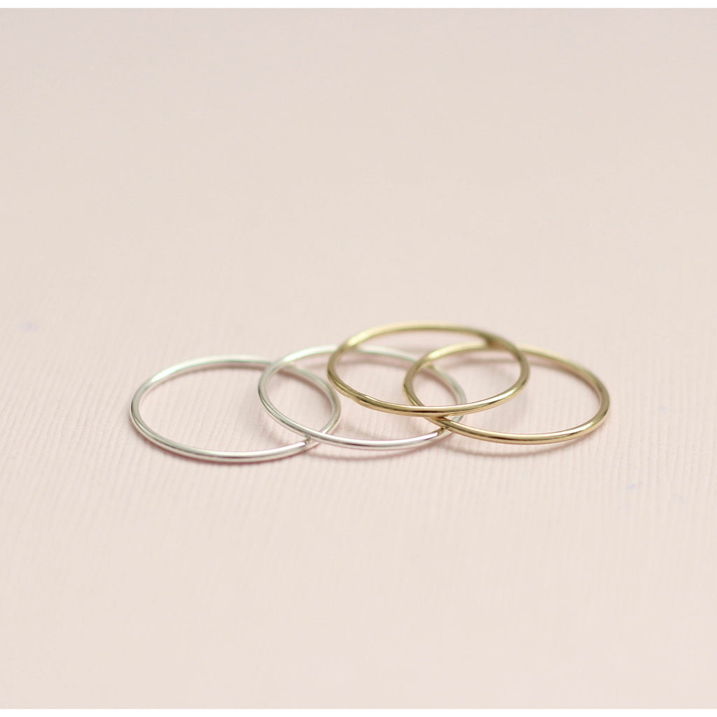 Plain minimal stackable rings in sterling silver and gold