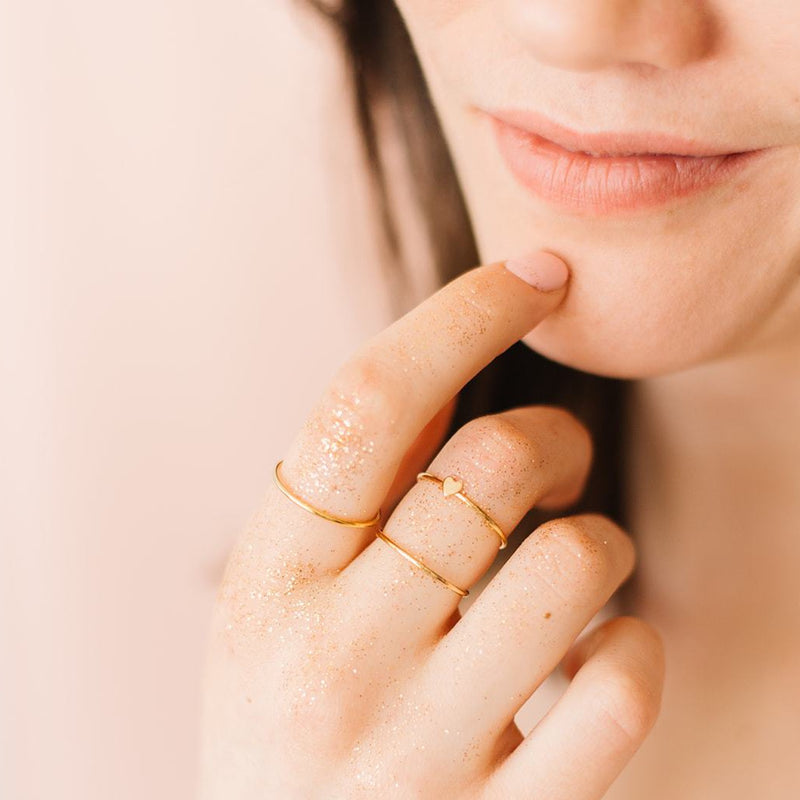 Woman wearing gold stackable rings