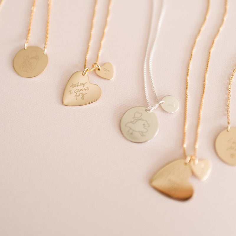 Custom handmade sterling silver and gold drawing necklaces using child' actual drawing. Available in coin and heart shape