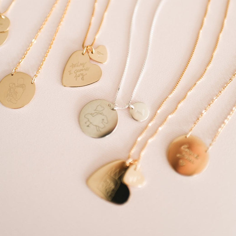 Variety of handmade custom drawing necklaces  using actual drawings. Available in sterling silver and gold