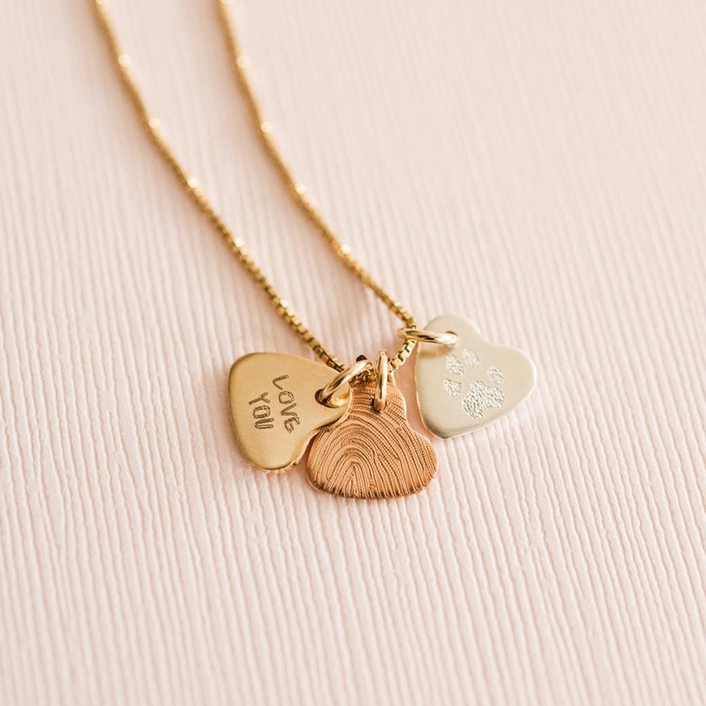 three hearts necklace that you can customize with fingerprints, paw prints or actual handwriting