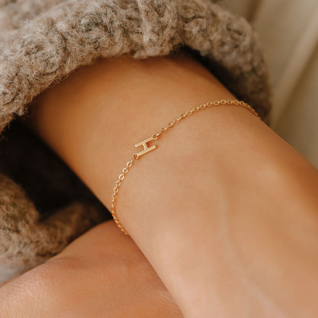 sideways letter bracelet with the letter H