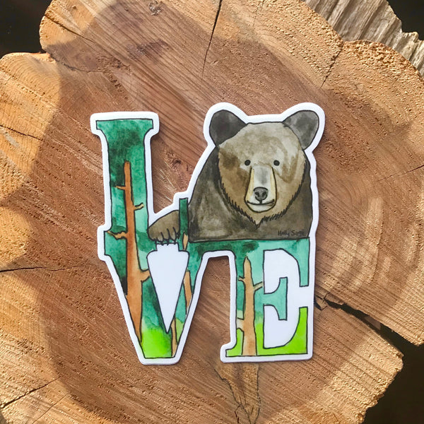 A sticker of the famous LOVE statue with a black bear replacing the O