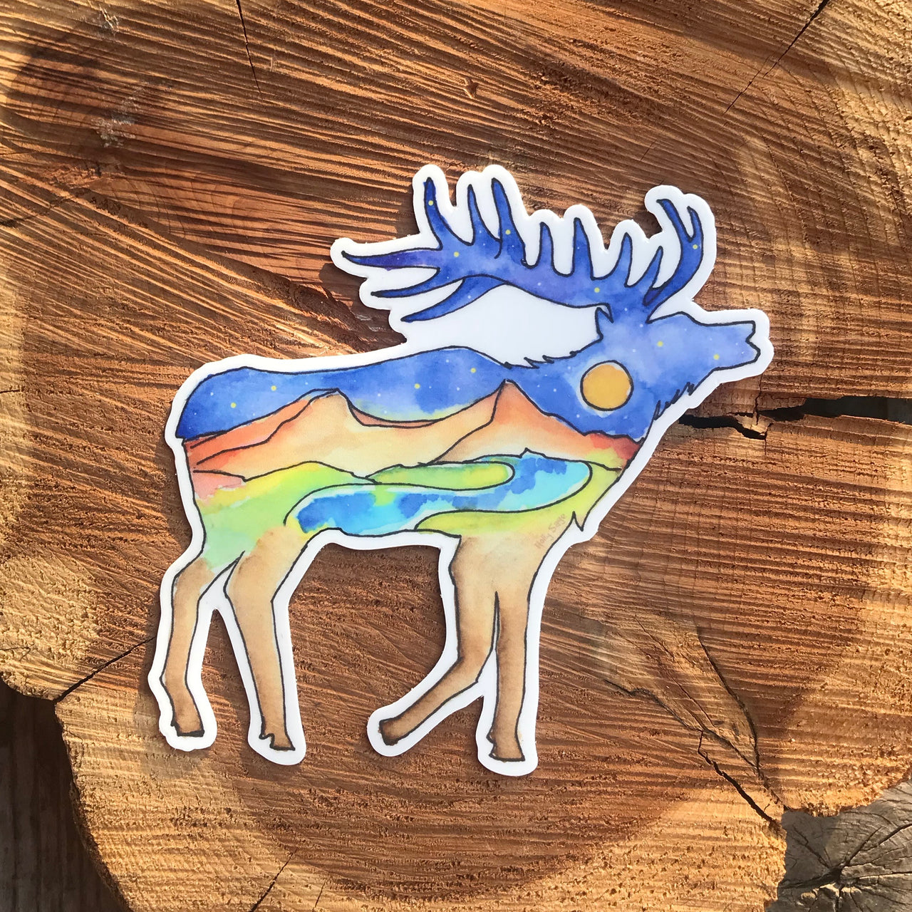 Mountain landscape under a night sky in an elk outline sticker