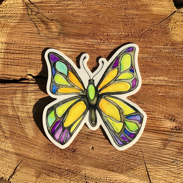 A butterfly sticker painted in the style of stained glass